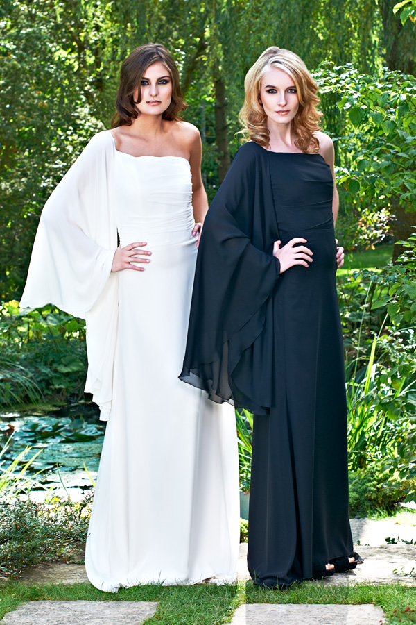 White and black asymmetric ethereal one shoulder long, shawl sleeve, draped garden wedding gowns